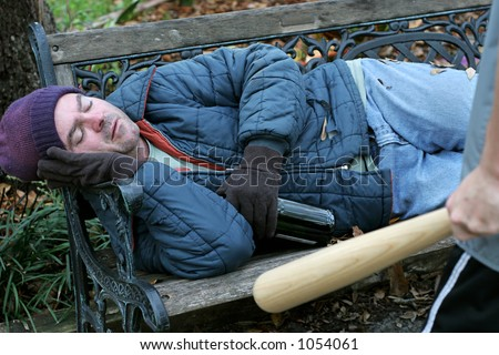 A homeless man sleeping while a teen with a bat sneaks up on him. - stock photo