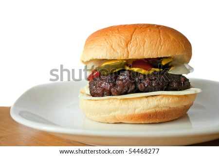 A homemade hamburger on a potato bun isolated over white with room for your text. - stock photo