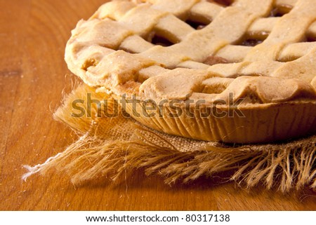 A homemade rhubarb pie on a wooden table ready to be eaten.  Fruit pie. - stock photo
