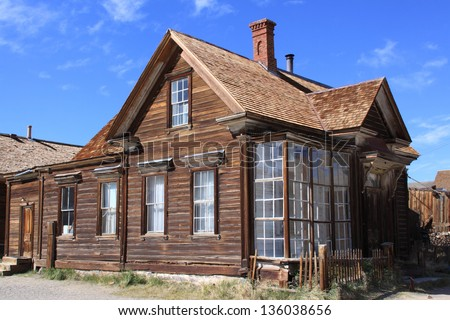 A homestead house in a vintage town on the american prairie. - stock photo