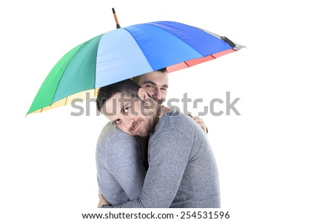 A homosexual couple over a white background on studio. - stock photo