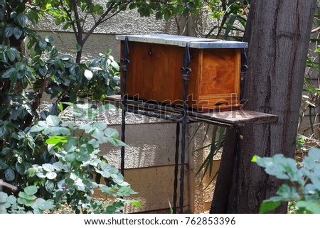 A Honey Bee Swarm Trap Or Bait Hive In Residential Garden Landscape Format