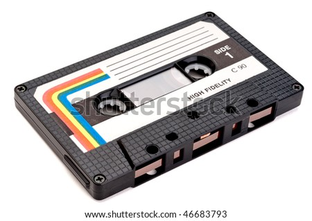 A horizontal close up of a vintage cassette tape on white - stock photo