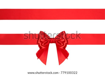 A horizontal color photo of a red gift wrap bow with ribbons isolated over a white background.