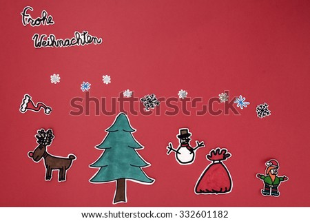 a horizontal overhead view of a scrapbook xmas greeting with a Happy xmas message in German - stock photo