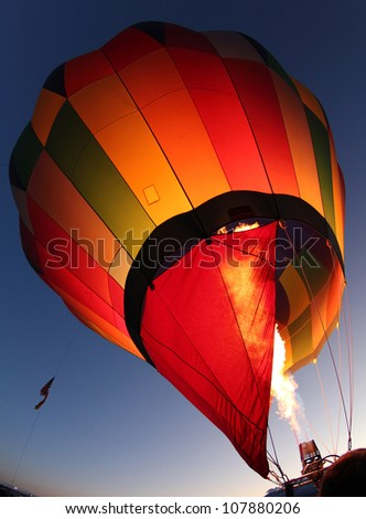 A hot air balloon getting inflated for early morning flight at the Albuquerque balloon festival, New Mexico - stock photo