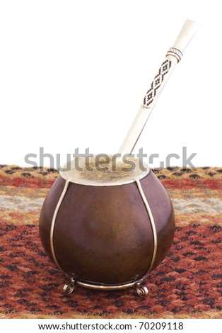 A hot Argentian mate with bomba/bombija sitting on woven jute mat. - stock photo