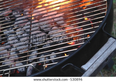 a hot charcoal barbecue grill in the summertime - stock photo