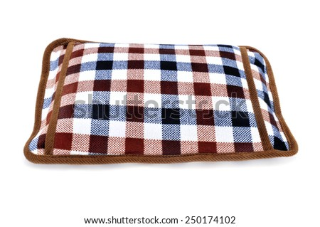 a hot water bottle with a pocket to introduce the hands on a white background - stock photo