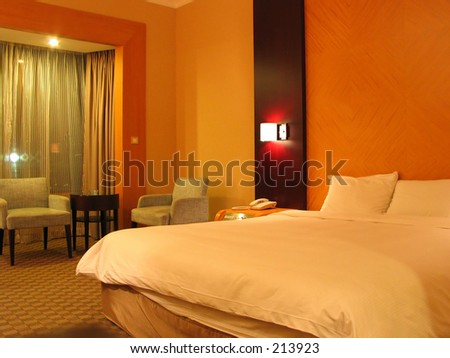 a hotel bedroom - stock photo