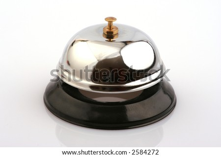 A hotel or service bell shining silver with a black base on a white background - stock photo