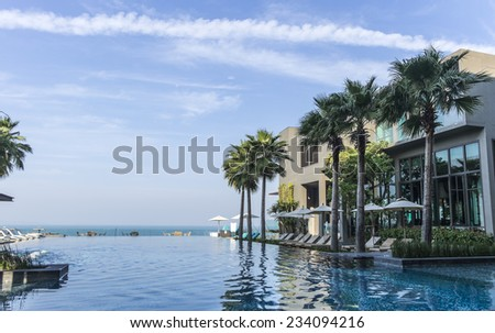 A hotel pool on the sea shore - stock photo