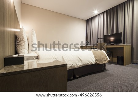 A hotel room, bedroom with twin bed, curtain, lighting front view at the day in seoul, south korea.