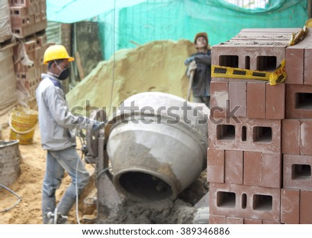 A house builder (bricklayer) at work. - stock photo