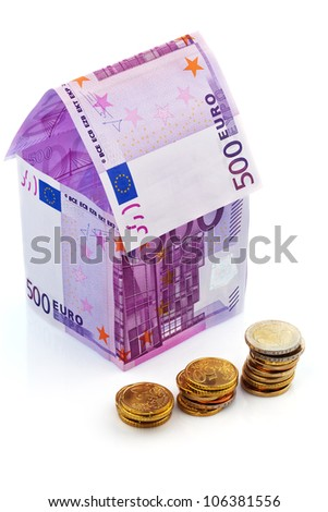 a house built with money seem �¢â���¬ on a white background. savings, house building and home buying. - stock photo