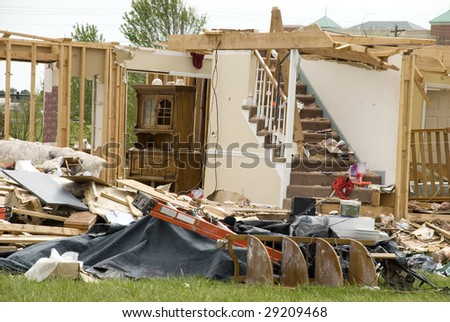 A house destroyed by a tornado, horizontal with copy space - stock photo
