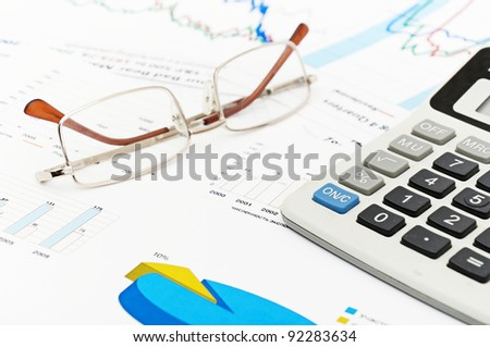 a house hold budget with glasses and calculator
