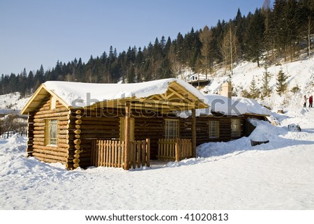 a house is   covered with heavy snow - stock photo
