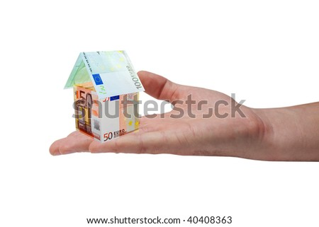 A house made from euro bills on man's hand - stock photo