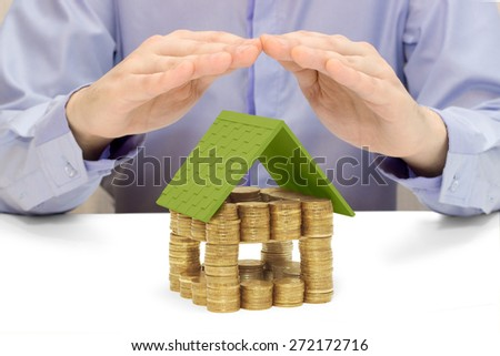 a house made of money, the hands of men - stock photo