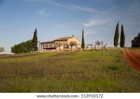 A house on a hilltop in Provence countryside at sunset, France, Europe - stock photo