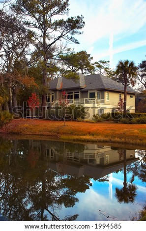 A house over a tranquil pond. More with keyword group12d