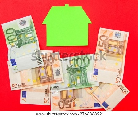A house surrounded by euros  - stock photo