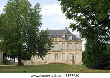 A house with garden in the country of Vendée, France - stock photo