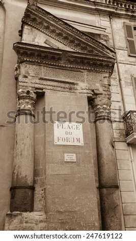 A house with Roman portico and columns at Forum square (Place du Forum) in Arles (Provence, France). Aged photo. Sepia. - stock photo