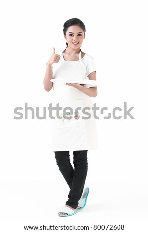 A housewife hold an empty plate , for you to put your product on it - stock photo