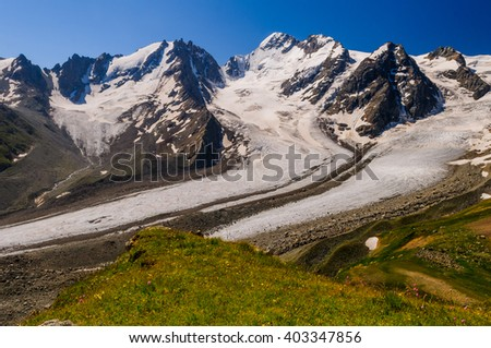 A huge Bartuy Glacier in the Caucasus Mountains, on a clear day - stock photo