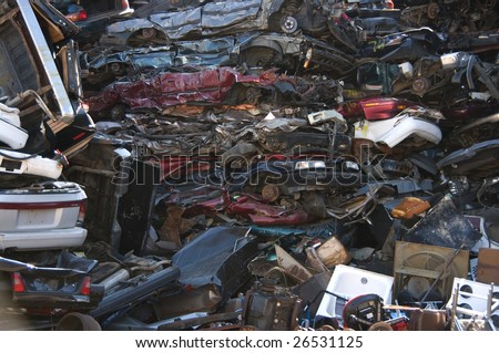 A huge pile of compressed cars going to be shredded - stock photo