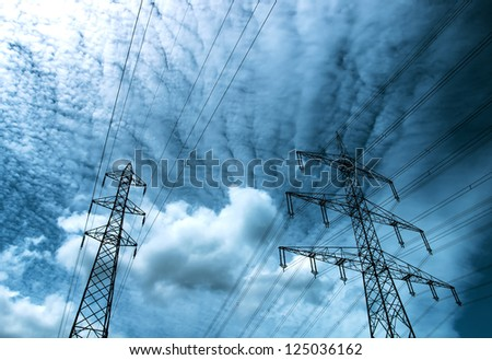 A huge pylon against the cloudy sky. - stock photo