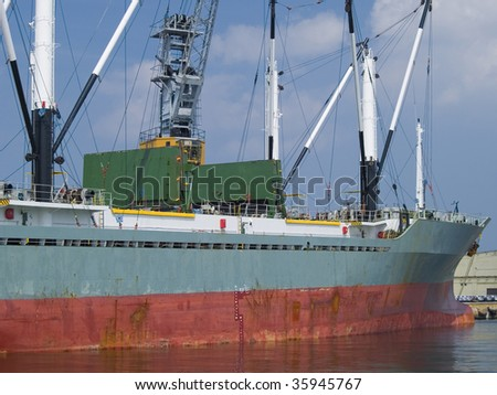A huge ship moored to wharf - stock photo