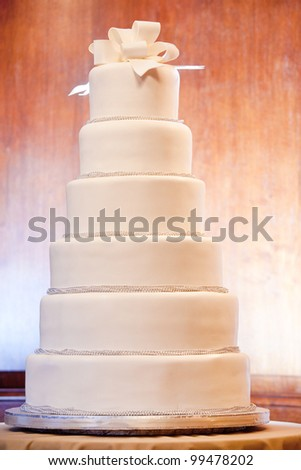 a huge six level white wedding cake on display - stock photo