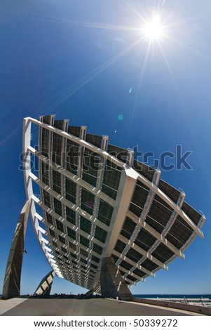 "A huge solar panel under the sun rays. It's located in the ""forum"" area of Barcelona. - stock photo"