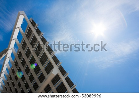 "A huge solar panel under the sun rays. It's located in the ""forum"" area of Barcelona. Horizontal version, shot with a rectilinear wide angle lens. - stock photo"
