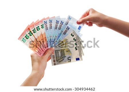 A human arm takes out 20 euro banknote from others - stock photo