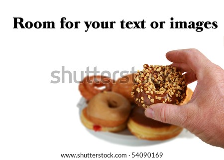a human hand grabs a donut - stock photo
