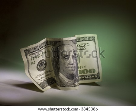 a hundred dollar bill on a green background