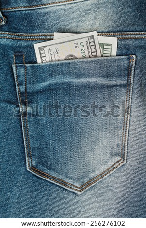 a hundred US dollars in the Jeans Pocket - stock photo
