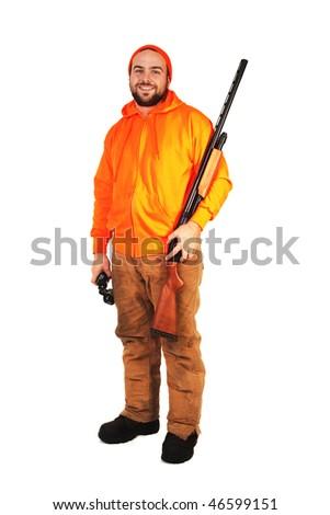 A hunter looking at the camera, holding a shotgun and binoculars - stock photo
