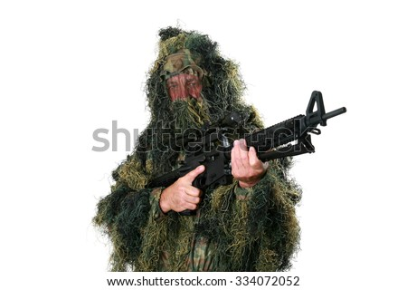 a Hunter or Sniper wears a Ghillie Suit to blend in with his surrounding woods or forest or field so he remains unseen by the enemy. Ghillie Suits are also worn for Halloween as a costume  - stock photo