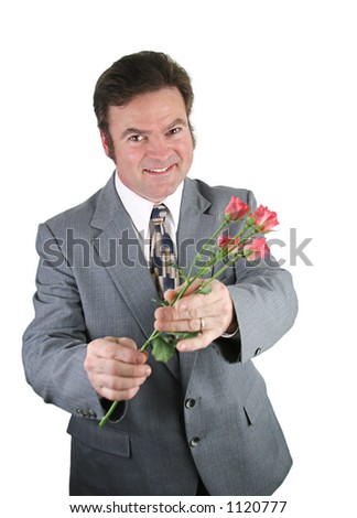 A husband apologizing to his wife by offering her pink roses. - stock photo