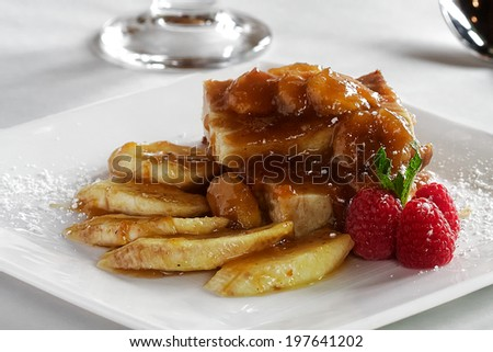 A hybrid dish of Bananas Foster and bread pudding - stock photo