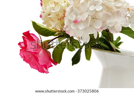A hydrangea with a roses in the vase isolated on a white - stock photo