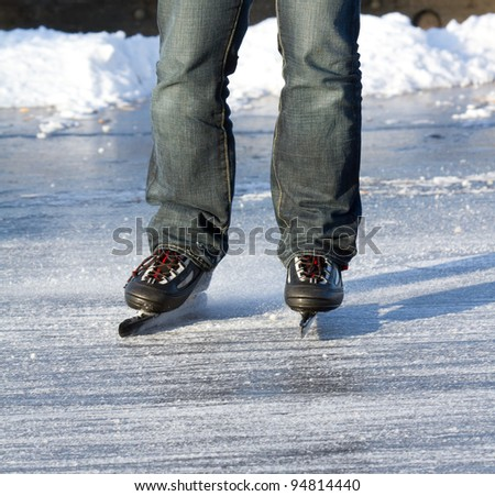 A ice skater is skating on the famous dutch Bonkevaart (Friese Elfstedentocht)