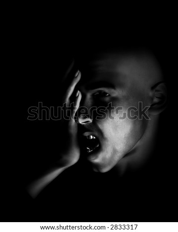 A image of a man in terrible expressive sorrow. Or he could have a head pain. - stock photo