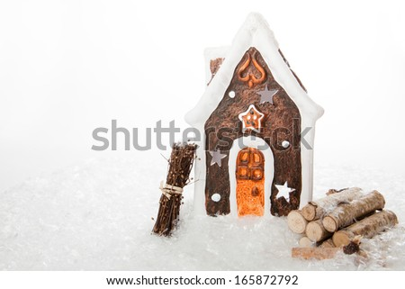 A isolated Gingerbread House with some wooden stuff. - stock photo
