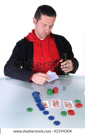 a isolated man gambling with his money - stock photo